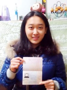 Li Chengjin with her passport and visa ready for Israel