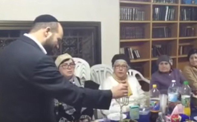 Rabbi Schwartz Hanukah candlelighting (from video)